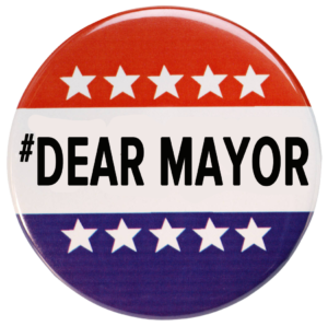 """Mayoral Button displays """"Dear Mayor"""" on red white and blue background"""